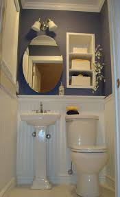 Modern Powder Room Bathroom Wonderful Wall Mounted Oval Mirror Over White Porcelain