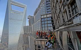 tourists walk on 100 metre long u0026 1 6 metre wide glass skywalk