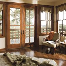 exterior design pretty interior design with pella doors plus cozy brown wooden pella doors with black handle matched with white wall and wooden floor plus wooden