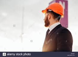 civil contractor male contractor or civil engineer looking at the building project