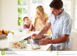 father preparing family breakfast in kitchen stock image image
