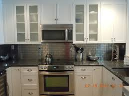 kitchen metal backsplash white with metal backsplash traditional kitchen new york