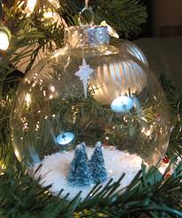clear glass ornament filled with epsom salt and glitter nestled