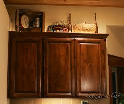Ideas For Decorating On Top Of Kitchen Cabinets by Antique Or Not Decorating Above Your Cabinets