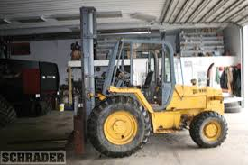 farm equipment auction from 2 owners schrader real estate and