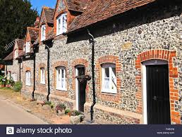 pretty brick and flint cottages with dormer windows along a