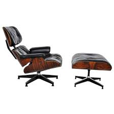 interior eames style lounge chair and ottoman in tan leather with
