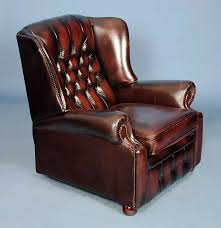 vintage red buttoned leather recliner armchair