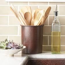 kitchen with subway tile backsplash and copper utensil
