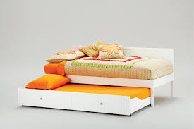 White Trundle Daybed Orange Cotton Bed Linen And Pillowcase On White Stained Wooden