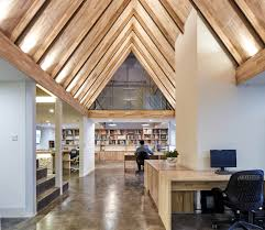 stepped roof creates dramatic office space freshome com collect this idea 1
