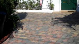 Cover Cracked Concrete Patio by Thin Pavers Over Concrete Driveway Vs Thick Brick Pavers Tampa Bay