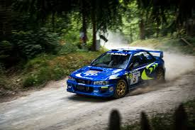 subaru sti rally car driving the goodwood festival of speed hill climb in a 2016 subaru