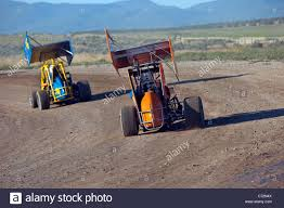 modified race cars race cars sprint high speed dangerous on dirt oval course highly