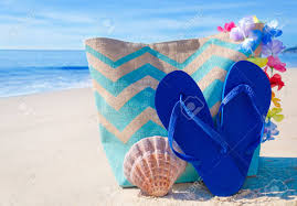 seashell flip flops bag with seashell and flip flops by the stock photo