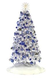 white tree with blue and silver decorations happy