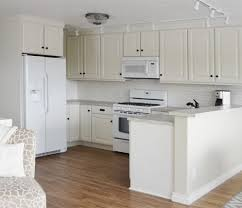 should baseboards match kitchen cabinets finishing details on kitchen cabinets white