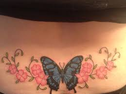 lower back butterfly with forget me not flowers tatoos