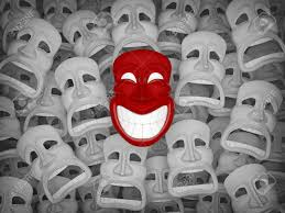 unique masks unique smiling mask among many sad masks stock photo picture
