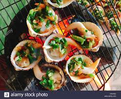 canape firr delicious shell or clams mussels on coal grill stock photo