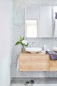 contemporary bathroom featuring tiled wall and floating vanity