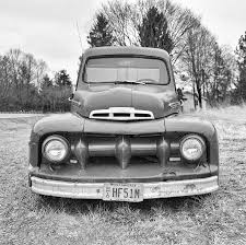 Old Ford Truck Bumpers - old ford truck in black and white photograph by brian mollenkopf