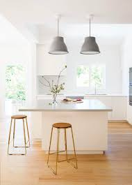 brass kitchen lights kitchen airy kitchen features light grey cabinet with low marble