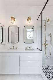 Black Mirror Bathroom Modern Black And White Bathroom With Brass Cage Sconces Modern