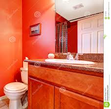 red bathroom corner with a washbasin cabinet stock photo image