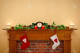 christmas stockings hanging over the fireplace at midnight on