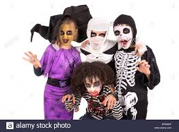 kids with face paint and halloween costumes isolated in white