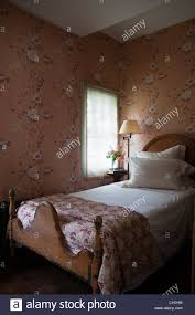 single bedroom single bed in 1830s hudson valley farmhouse bedroom with patterned