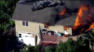 neighbors rescue elderly man threatened by garage fire nbc 7 san