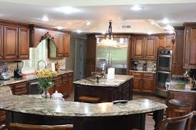 granite countertop kitchen cabinets hanging from ceiling copper