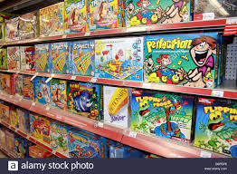 board games on shelf in toy store united states stock photo