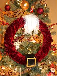 the middle thanksgiving circle brown ornaments with yellow orange feather also brown head