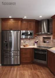 like the tone of the rustic knotty alder kitchen cabinets would