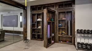 basement gym with hidden bookcase open best home gym decorating