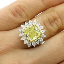 fancy yellow diamond engagement rings 6 27 cts cushion fancy yellow diamond engagement ring set in 18k