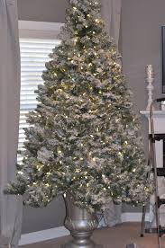flocked christmas tree decorating christmas lights decoration