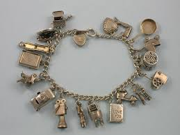 bracelet charm gold silver images The love nest charmed i 39 m sure a collection of charm bracelets jpg