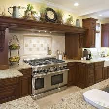 kitchen cabinet decorating ideas decorate the space above your kitchen cabinets handyman tips