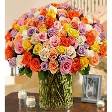 send roses online 100 premium stem multicolored roses in a vase send roses