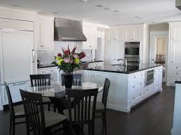 granite countertop kitchen blue walls white cabinets samsung