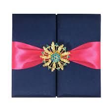navy blue wedding folder with fuchsia ribbon u0026 gold flower brooch
