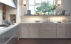 concrete counter underlit shelf over sink continuous range hood