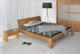 Black Headboards For Double Beds by Brown Wooden Bed Having Wooden Headboard And Patterned Blanket