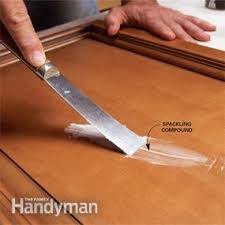 How To Touch Up Wood Cabinets How To Spray Paint Kitchen Cabinets Family Handyman
