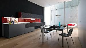 italian modern kitchen design with black cabinetry and dining area