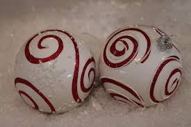 swirley and white glass ornament exclusively